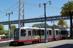 Breda LRV and the Oakland Bay Bridge.
