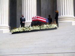 Casket Guarded by Clerks at West Façade of US Supreme Court Building from Southwest During Lying in Repose of Associate Supreme Court Justice Ruth Bader Ginsburg