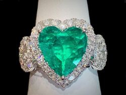 Heart cut emerald ring with diamonds