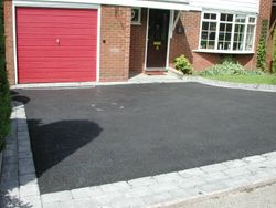 Tarmac with cobbled border