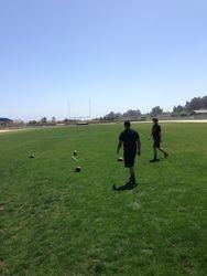 Cole and Jesus shagging footballs.