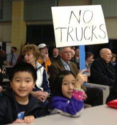 "Children Held Signs ""NO TRUCKS"""