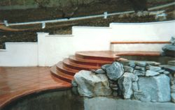 Concrete steps with bullnose edge, block wall with stucco finish