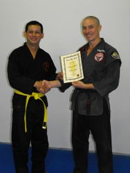 Edward recieving his Yellow Belt Certificate