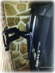 tv wall mount installation on full motion bracket on brick wall (Bracket view)