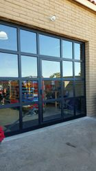 Glass Sectional with Man Door
