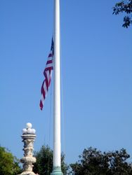 Close-Up of North Flag at Half Staff Outside West Façade of US Supreme Court Building from Southwest During Lying in Repose of Associate Supreme Court Justice Ruth Bader Ginsburg