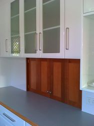 16. Two-Way Glass Overhead Cupboard with Bi-Fold Doors.