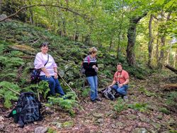 Debbie, Diana, and Jeff Mooney resting on the old logging trail just above the crash site.