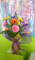 Mixed Coloured Gerberas in Netting Vase