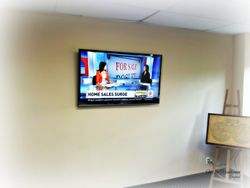 "55"" flat screen TV wall mount installation"