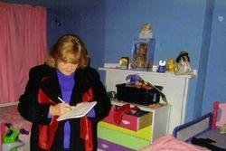 Lorrie takes notes during walkthrough,