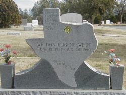 "gray granite ""Texas"" marker with tapered vases"