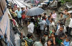 28 Filming at the end of the monsoon in Sanjay Camp slum, Delhi