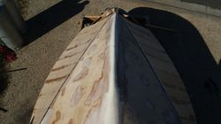 First layer of 12' planks on the top sides to achieve the flare.