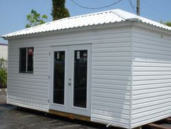 10x18 / hip and Permatile roof / home door