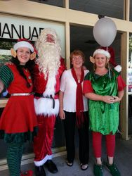 Pat with Father Christmas and the elves