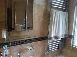 'Hudson Reed' Mirror Unit with above bath chrome towel rail.