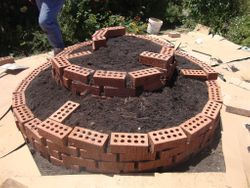Extra bricks for stabilising the growing medium in each level, until the herbs can get established