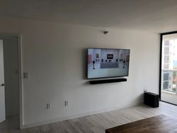 Why would you not put the TV on the wall!