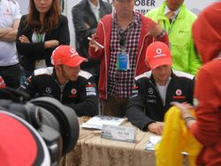 Jenson and Lewis signing away for the fans
