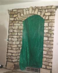 Création ouverte voûtée en pierre