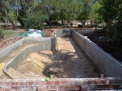 Shaping of pool base