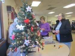 Checking out decorations for small tree