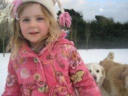 Grace with Nana's dogs