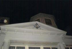 Masonic emblem against