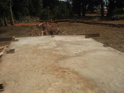 The finished concrete top of the water tank platform. Note the slope away from the center line for drainage
