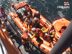 Couple rescued from a liferaft after their boat's engine room had a fire