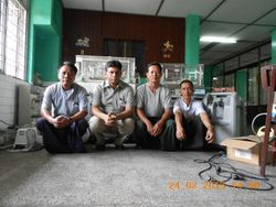 WITH TECHNICIANS AND REPAIRED MACHINES