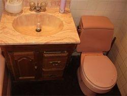 New floor, vanity, and toilet before pic