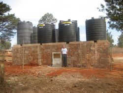 The water storage platform with the eight 5,000 liter storage tanks.  The tanks are empty awaiting the concrete to finish curing