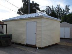 10x16 with a hipp roof and galvalume