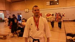 Ash with medal