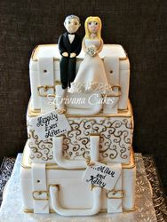 Gold and white suitcase wedding cake