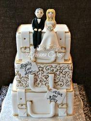 Gold and white suitcase wedding cake