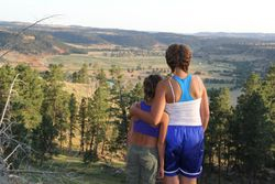 Two girls looking at a mountain view