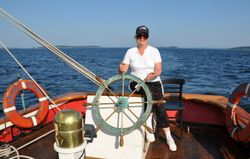 Priscilla at the helm of the Appledore