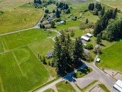 Pastures, parking lot, outbuildings & little barn