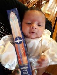 Kion and his baptismal candle