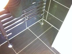 Towel rail chrome pipe work and valves.