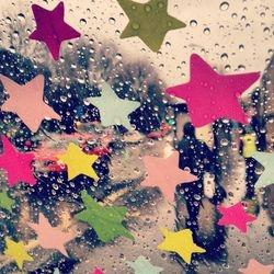 Raindrops through my colourful umbrella