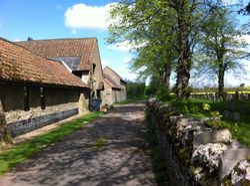 St. James' Church Barn on the left