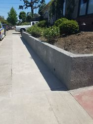 Built retaining wall and cleared landscape on top