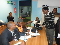 Delegates taking their ballot papers