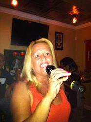 Wanda sharing her singing style with the crowd at Legendary Friday Night Karaoke