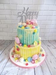 70th birthday yellow and blue drip cake